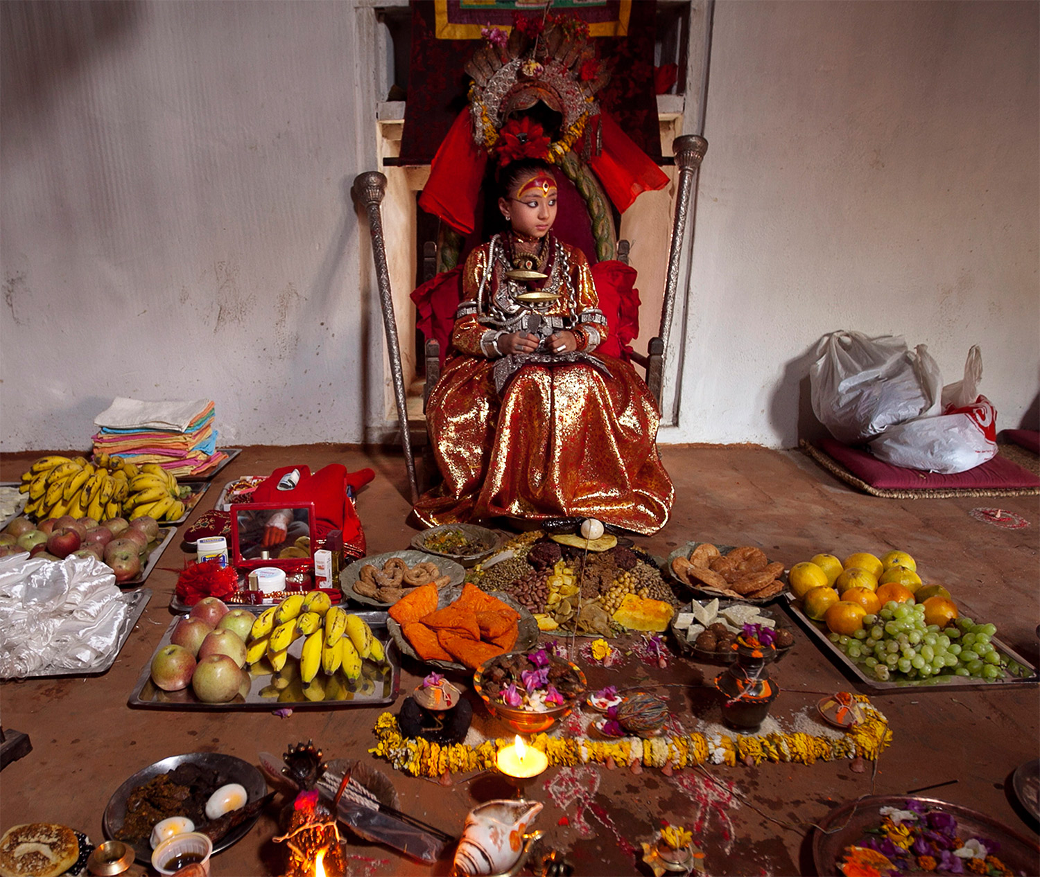 The Kumari Samita Bajracharya with offerings from worshippers, Patan, Nepal, 2011. Narendra Shrestha / EPA / Corbis Images