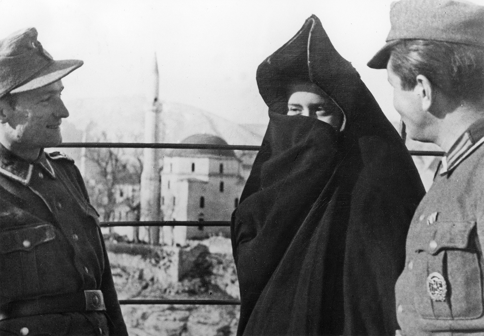 German soldiers talk to a Muslim woman in Mostar, Herzegovina, 1944.