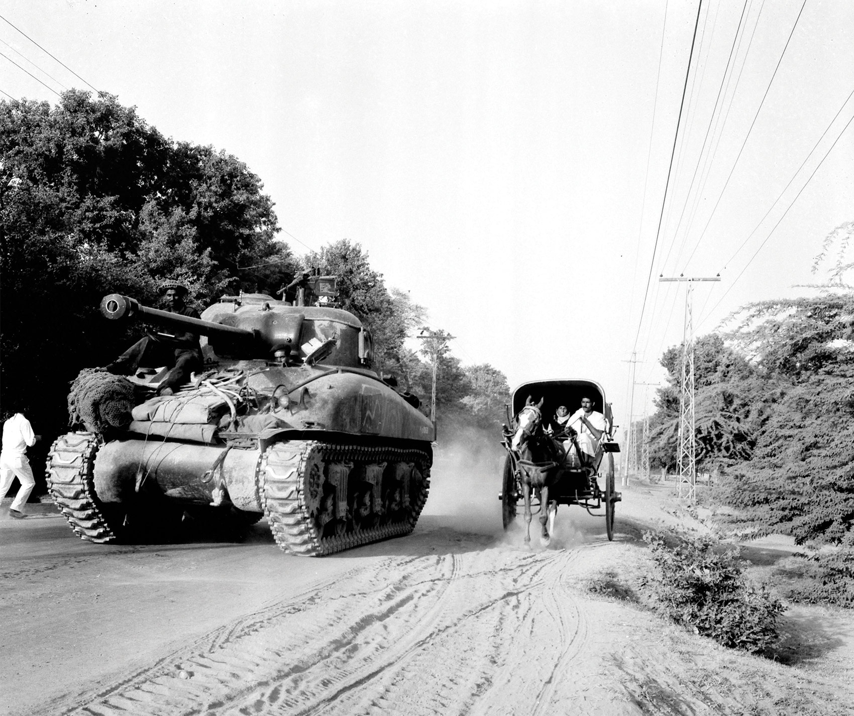 A US-built Sherman tank of the Pakistani army rumbles through Slalkot in the Pakistani Punjab in September 1965.