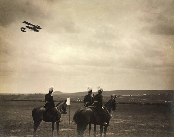 A military biplane flies over Salisbury Plain c. 1914. Getty Images/SSPL