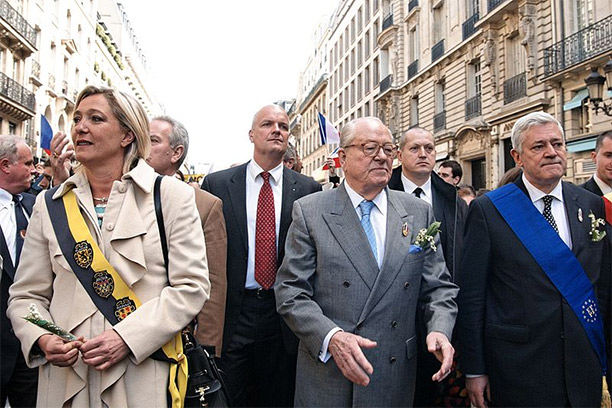 Marine Le Pen, Jean-Marie Le Pen and Bruno Gollnisch, May 1st 2010 at the Front National's rally in honour of Joan of Arc. By Marie-Lan Nguyen