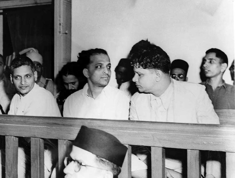 Nathuram Vinayak Godse, seated on the left of the front row, at the trial.