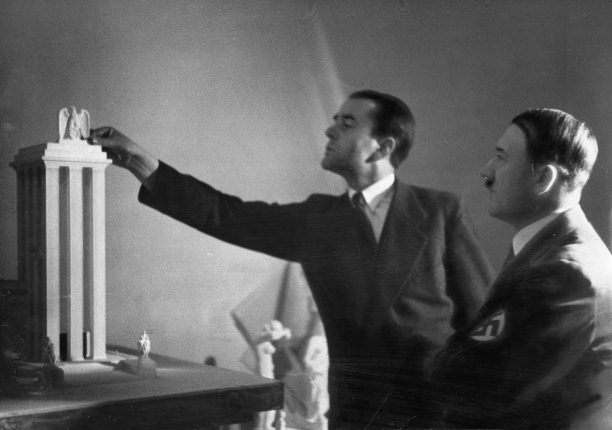 Albert Speer presents Hitler with a model of the German Pavilion designed for the World's Fair in Paris, 1937.