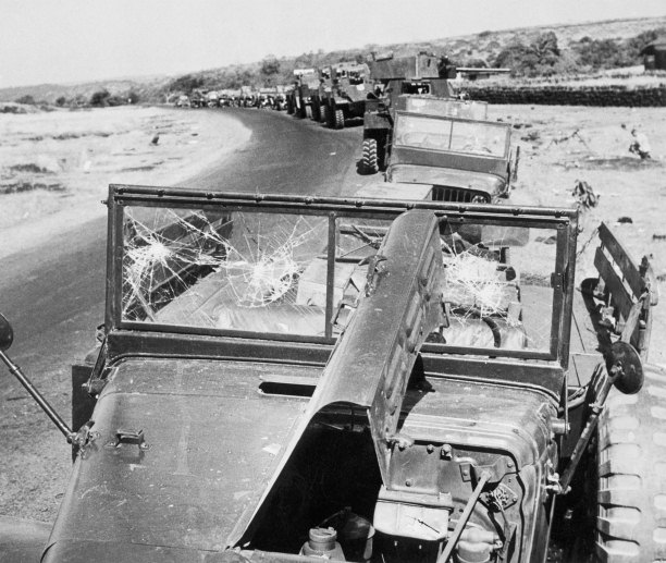 Damaged Portuguese military vehicles line the route to Panjim Airport, Goa, December 19th, 1961. Corbis/Bettmann