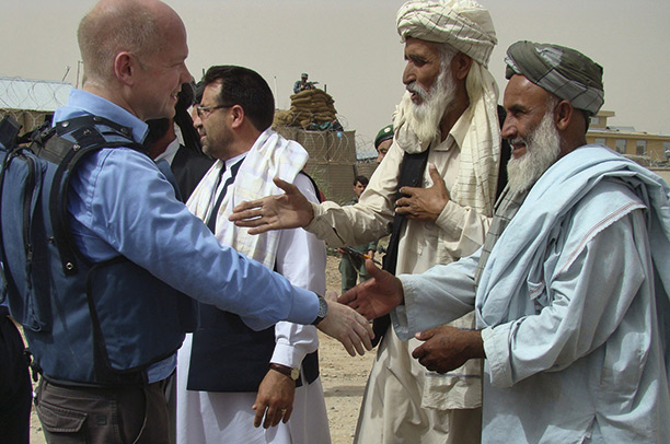 History man: William Hague shakes hands with Afghan elders during his visit to Helmand province, May 2010. AP Photo/Abdul Khaleq