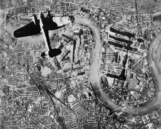 A German Luftwaffe Heinkel He 111 bomber flying over east London, 7 September, 1940