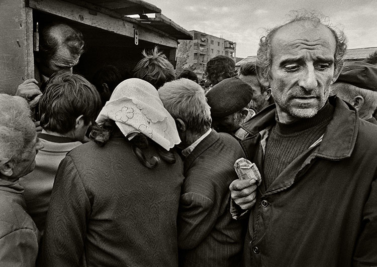 Albanians searching for food at a market stall in Milot, April 1991.
