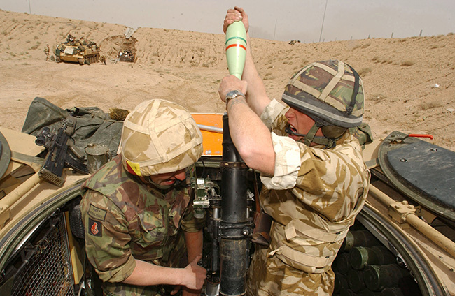 British soldiers engage Iraqi Army positions south of Basra, 26 March 2003.