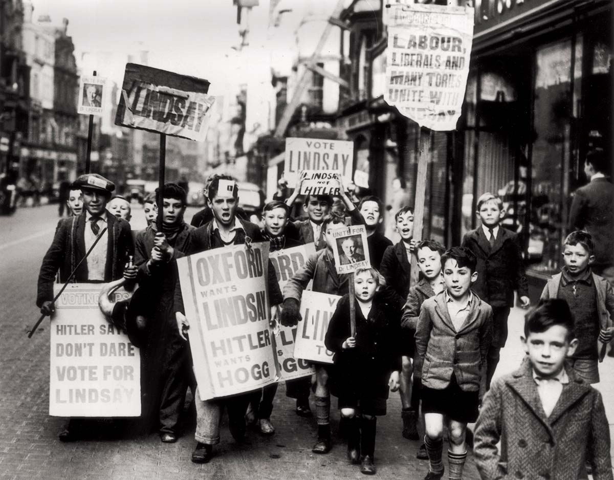 'Hitler wants Hogg': children with placards supporting A.D. Lindsay, Oxford, 27 October 1938.