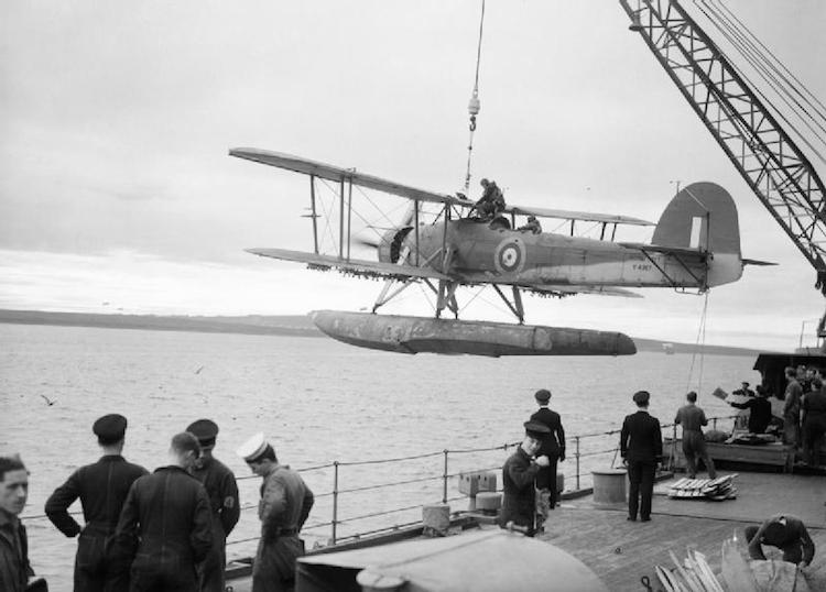 A Swordfish floatplane is hoisted aboard the battleship HMS Malaya in October 1941.