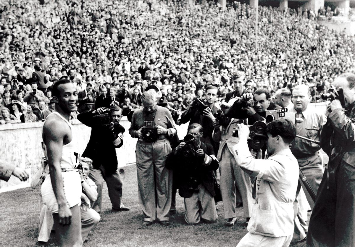 Defiant: Jesse Owens after winning the 100m at the Berlin Olympics, August 1936 © Getty Images