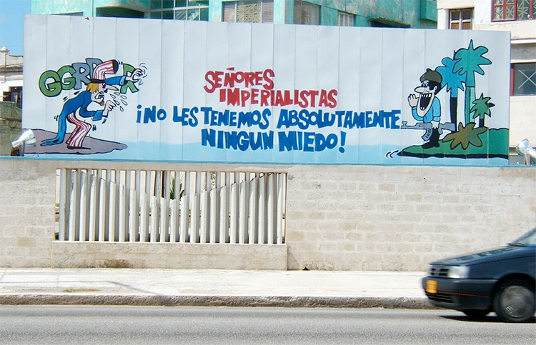 Cuban propaganda poster in Havana featuring a Cuban soldier addressing a threatening Uncle Sam. Photo by KPu3uC B Poccuu