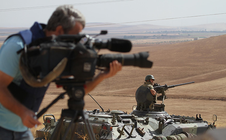 Recorded history: a cameraman follows troop movements in Northern Iraq, 2014.