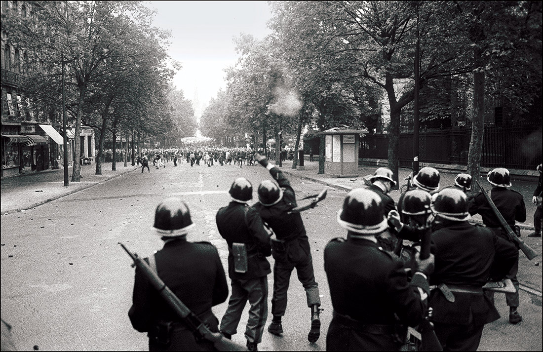Revolting: members of the CRS throw grenades during student riots in Paris, 1968.
