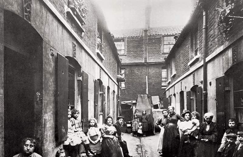 Slum in Victorian London, 19th century. (Bridgeman Images)
