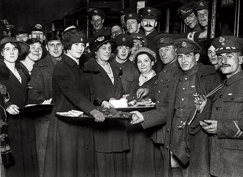 Equal rewards: returning soldiers are welcomed at a railway station, 1917.