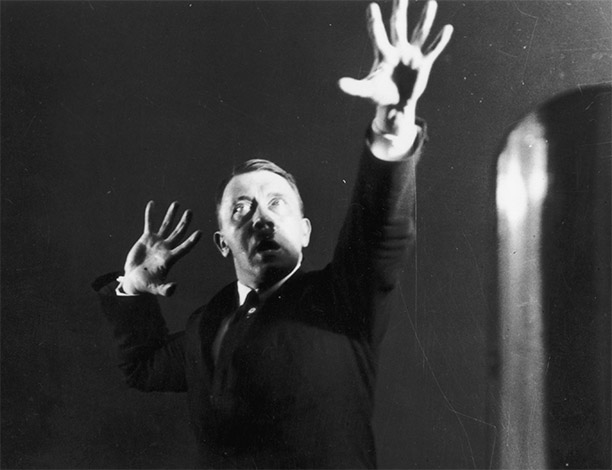 Hitler miming gestures to a record of his speeches; one of an extraordinary series of photographs he commissioned in 1925 to aid self-analysis and improve his hold over an audience