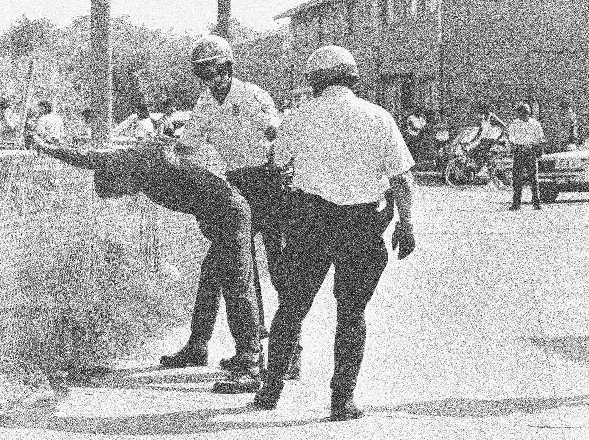 Police search a man following a drugs raid in Quarles Street, Washington, 19 July 1985. Linda Wheeler/The Washington Post/Getty Images.
