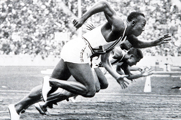 Race winner: Jesse Owens competing in the 100 metre sprint at the 1936 Olympics