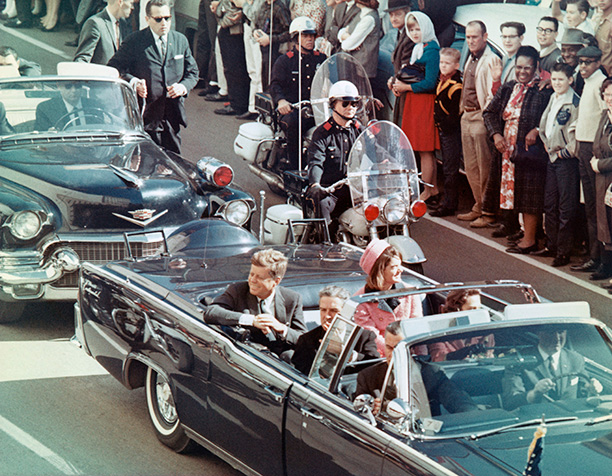 President and Mrs Kennedy in the Dallas motorcade, moments before the shooting. Governor John Connally sits in front of the president. Corbis/Bettmann