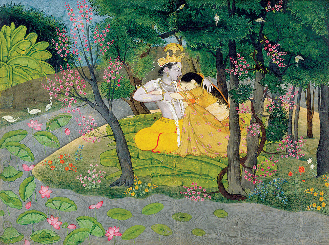 Radha and Krishna Embrace in a Grove of Flowering Trees, North India, c.1780.