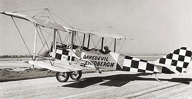 """Daredevil Lindbergh"" in his Curtiss JN-4 ""Jenny"" in 1923."