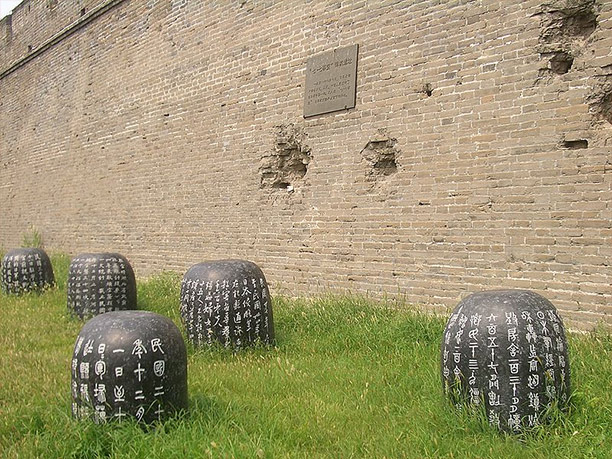 Damage from the Japanese shells on the wall of Wanping Fortress marked with a memorial plaque. Photo / Vmenkov