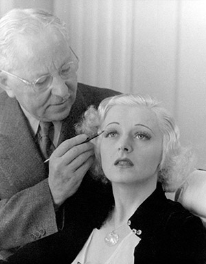 Touch of class: Max Factor applies make-up to a model, 1937