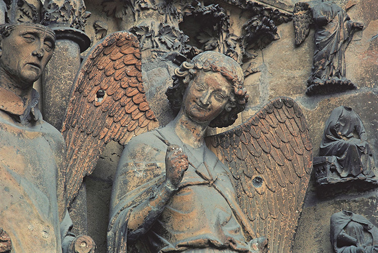The Smiling Angel of Reims Cathedral. Christian Cuny / Getty Images