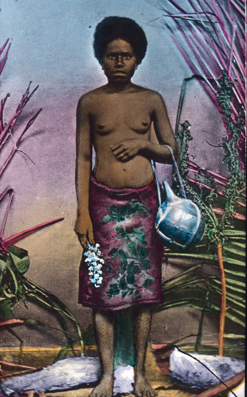 Hand-coloured studio photograph of a New Caledonian woman, early 20th century.
