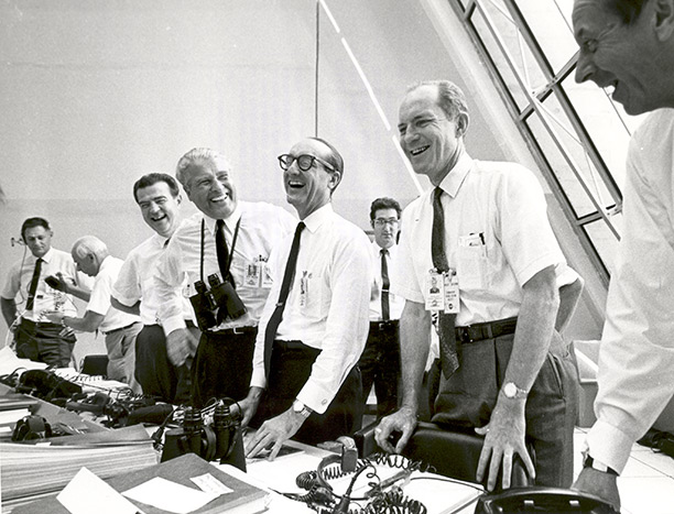 Officials at the Launch Control Center in Houston, Texas following the Apollo 11 mission's lift-off, with Werner von Braun, George E. Mueller and General Samuel C. Phillips at the centre. NASA