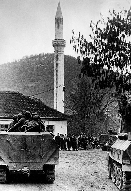 German armoured personnel carriers in a Bosnian Muslim village, 1944.