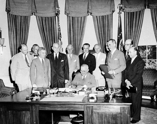 President Truman signs the treaty