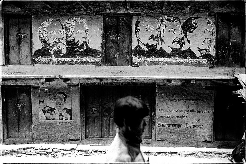 Defaced portraits of communist leaders in Thawang, June 2005.
