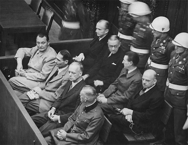 Defendants in the dock at the Nuremberg trial. On the left side of the front bench is Hermann Göring..