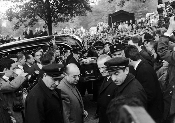 Voice of the people: Piaf's coffin is carried through Pere Lachaise cemetery