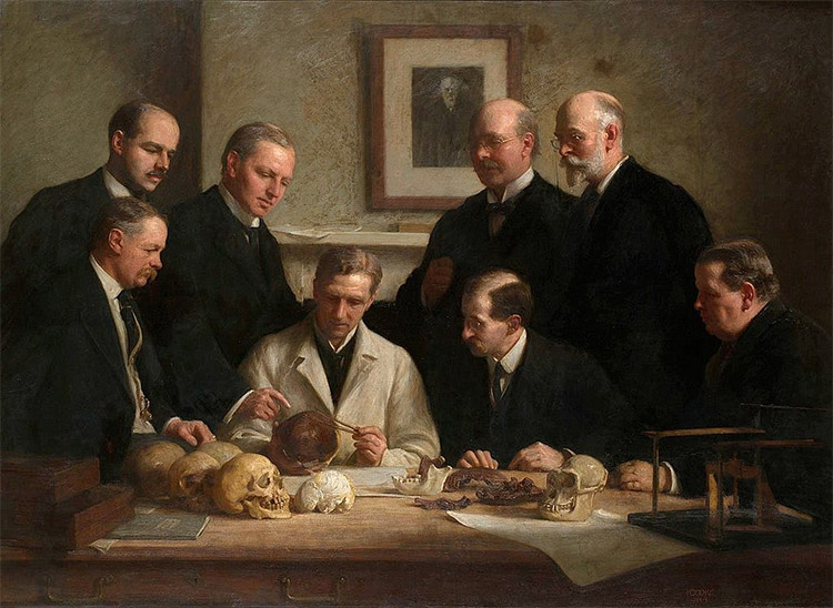 Group portrait of the Piltdown skull being examined