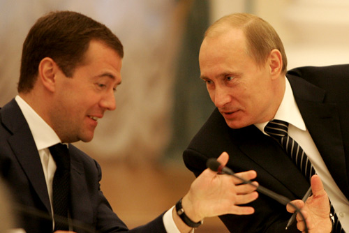 Vladimir Putin (r) with Dmitry Medvedev