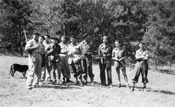 Maquisards (Resistance fighters) in the Haute-Savoie département in August 1944. Third and fourth from the left are two SOE officers