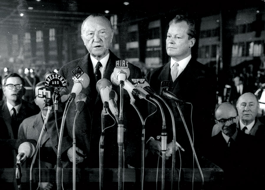 West German Chancellor, Konrad Adenauer, makes his farewell speech before resigning from office on 15 October 1963, with Willy Brandt, Chancellor 1969-74, on his left.