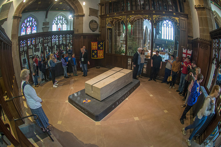 Visitors circulate around Richard's tomb in the chancel.
