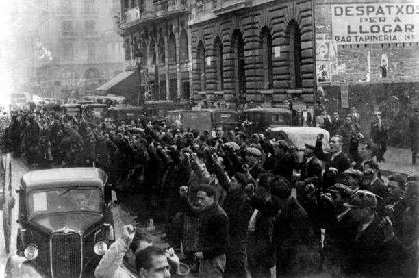 British volunteers with clenched fists gather in Barcelona, December 1936