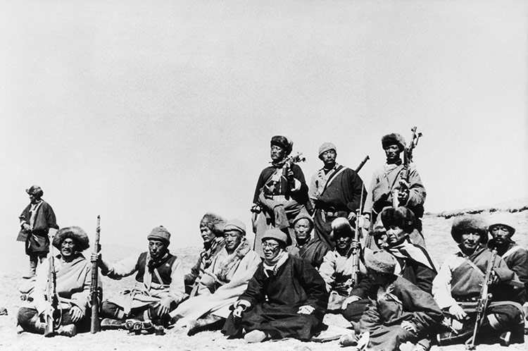 The 14th Dalai Lama (front, in black) flees Tibet for India with his Khamba warrior guards, 1959.