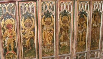 The medieval screen depicting the nine orders was defaced by William Dowsing at the church of St Edmund, Southwold, Suffolk. 'We brake 130 superstitious pictures,' he wrote of his visit there, in April 1643.