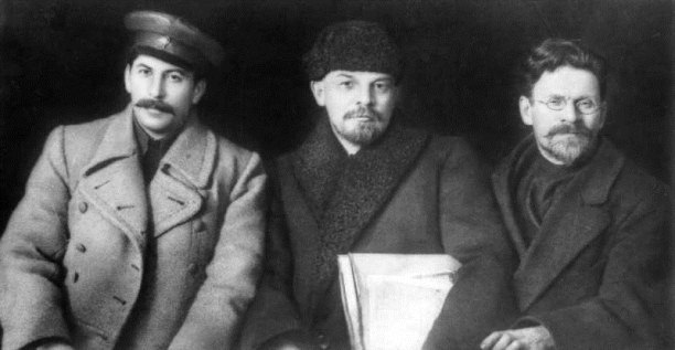Falsified detail of a photo from the VIII Congress of the Russian Communist Party , March 1919. L-R: Stalin, Lenin, and Mikhail Kalinin