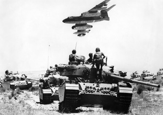 An Israeli Vautour  bomber flies over tanks assembling in the Negev desert on May 24th,  1967, two weeks before the outbreak of the  Six Day War.  © Topfoto