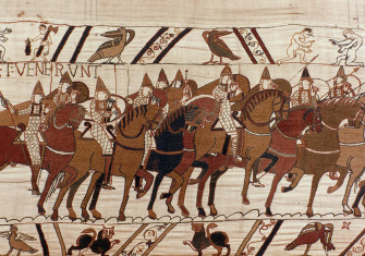The Normans advance in battle.