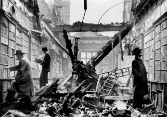 Holland House library after an air raid, 23 October 1940. This photograph was likely staged for propaganda purposes. Wiki Commons.