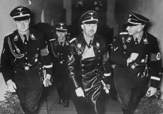 Karl Wolff, Heinrich Himmler and Reinhard Heydrich attend the premiere of the film Verräter (Traitor), Nuremberg, 1936 © akg-images