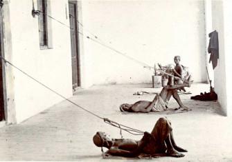 Three Indian men on a verandah pulling punkha strings, c.1900 © Royal Society for Asian Affairs, London/Bridgeman Images